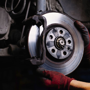 Car Mechanic Checking Brake