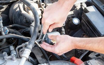 Volkswagen Mechanic Unscrewing Fuel Filter